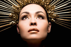 Close up view of attractive woman in golden headpiece looking up Royalty Free Stock Photos