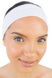 Close up view of attractive woman wearing a headband and looking at camera Royalty Free Stock Photo
