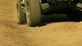 Close up view of ATV wheels in terrain. stock footage