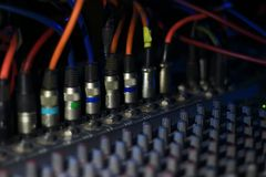 Close up view of knobs and sliders of light and sound board console at a concert theater royalty free stock image