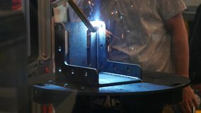 Close-up view of automatic robotic arm making metal welding operations. Media. Different working robots collection stock video footage