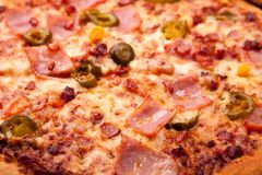 Close up view of baked piza ingredients. Close up view of baked homemade piza ingredients stock photos