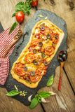 Mixed pizza with chicken, pepper, olives, onion, basil on pizza board. Close up view of baked homemade piza. Rustic pizza home made food. Tasty pizza with stock photos