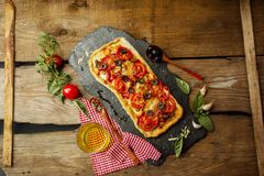 Mixed pizza with chicken, pepper, olives, onion, basil on pizza board. Close up view of baked homemade piza. Rustic pizza home made food. Tasty pizza with royalty free stock photo