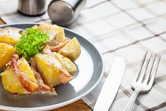 Close up view on baked potato with fried bacon. Traditional american fast food for dinner or lunch. Pocture for recipe. Copy space stock photos
