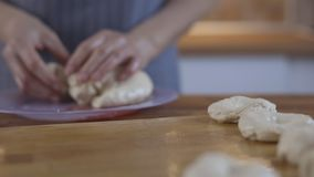 Close up view of baker kneading dough. stock video
