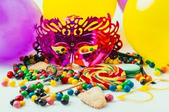 Close up view of balloons, masquerade masks and candies, purim. Holiday concept royalty free stock images