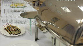 Close-up view of banquet table served with canape and appetizers. stock video