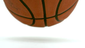 Close up view of a basketball falling down Stock Photography