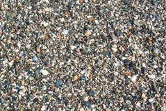 Close up view of beach with small stones. Sand and shells at Malaga, Andalusia, Spain stock photo