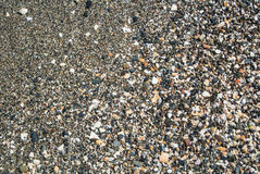 Close up view of beach with small stones, sand and shells. At Malaga, Andalusia, Spain royalty free stock photo
