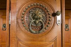 Highly detailed door knob. Close up view of a beautiful detailed doorknob in the shape of a lion Royalty Free Stock Photo