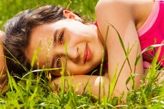 Close up view of beautiful girl on green grass Royalty Free Stock Image