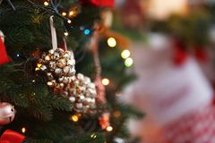 Close up view of beautiful jingle bells on Christmas. Tree Royalty Free Stock Images