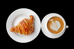 Coffee and croissant breakfast on a plain black background. stock images