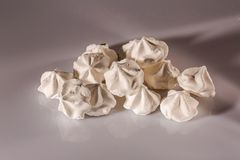 Close up view of beautiful white meringue cookies. Traditional dessert of French/ Swiss /Italian cuisine royalty free stock image