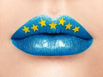 Close up view of beautiful woman lips with blue lipstick Royalty Free Stock Photo
