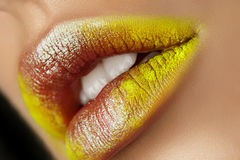 Close up view of beautiful woman lips with fashion makeup. Open mouth with white teeth. Cosmetology, drugstore or fashion makeup concept. Beauty studio shot Stock Photos