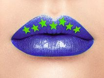 Close up view of beautiful woman lips with purple lipstick Stock Photos