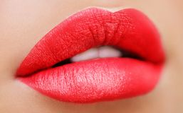 Close up view of beautiful woman lips with purple matt lipstick. Open mouth with white teeth. Cosmetology, drugstore or fashion stock image