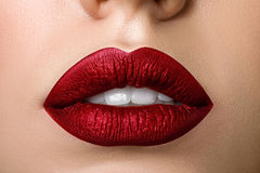 Close up view of beautiful woman lips with red matt lipstick Royalty Free Stock Photos