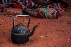 Close up view of a berber teapot on the Sahara`s sand stock photo
