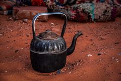 Close up view of a berber teapot on the Sahara`s sand stock photography