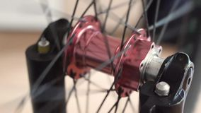 Close-up view of the bicycle hub. Rotating bmx or mtb wheel. In Odessa stock footage