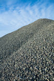 Close up view on big pile of gray gravel. On background of blue sky Royalty Free Stock Photography