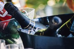 Close Up View of Black Glass Wine Bottle on Stainless Steel Bucket Royalty Free Stock Photos