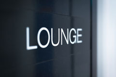 Black sign to lounge room in airport. Royalty Free Stock Image