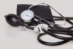 Close up view of black stethoscope and sphygmomanometer kit stock image