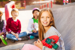 Close up view of blond girl with skateboard Stock Photo