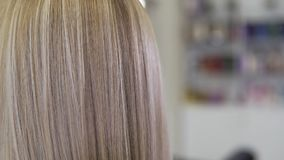 Close up view of blonde hair. Young beautiful girl in beauty salon. stock video footage