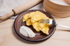 Close up view of boiled varenyky or dumpling with cottage cheese. Close up view of boiled varenyky or dumpling on metal fork. Fresh boiled homemade ukrainian Stock Photos