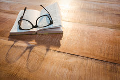 Close up view of a book and glasses Royalty Free Stock Images