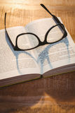 Close up view of a book and glasses Stock Image