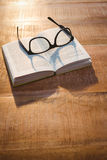Close up view of a book and glasses Stock Photography
