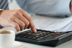 Close up view of bookkeeper or financial inspector hands making Royalty Free Stock Images