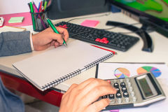 Close up view of bookkeeper or financial inspector hands making report, calculating or checking balance. Home finances, investment Royalty Free Stock Photo