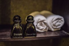 Close up view on the bottles with shampoo, shower gel and towels in the hotel bathroom stock photo