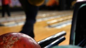 Close-up view of bowling player hand taking colorful ball from bowl lift. Media. People playing bowling - the bowling. Close-up view of bowling player hand stock video footage