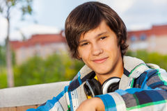 Close up view of boy wearing headphones Stock Photo