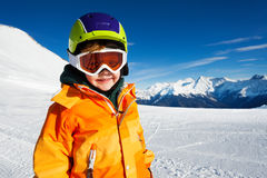 Close-up view of boy wearing ski mask on ski-track Stock Images