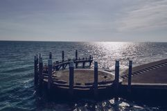 Close up view of breakwater and sea in sunlight. At Oudeschild on Texel island royalty free stock photo