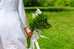 Close-up view of a bride holding a bouquet white flowers Stock Photos