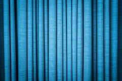Blue curtain in folds. Textured background. Royalty Free Stock Photography
