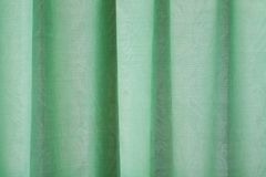 Close-up view of bright green curtain Royalty Free Stock Photo