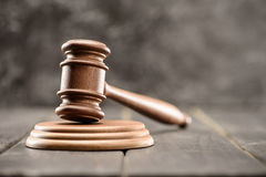 Close-up view of brown mallet of judge on wooden table on grey Stock Photography