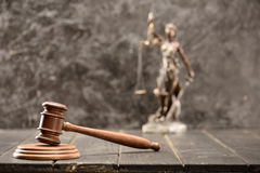 Close-up view of brown mallet of judge on wooden table Stock Photos